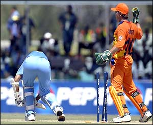Rahul Dravid is bowled by Tim de Leede for 17