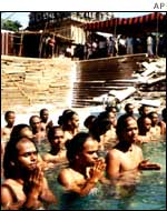 Brahmin youths perform a Varia Japan prayer in neck-deep water in Madras
