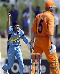 Harhajan Singh celebrates the wicket of Tim de Leede