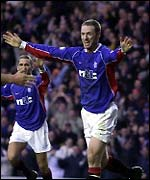 Craig Moore celebrates with Rangers