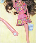 Barbie doll with a broken leg