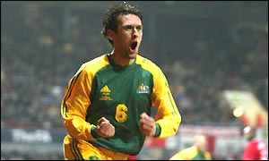 Tony Popovic celebrates scoring Australia's first goal