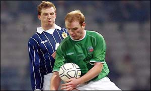 Ireland's Gary Doherty gets the better of the internationally inexperienced Stephen Caldwell