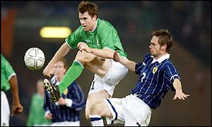 Kilbane tries out an acrobatic challenge on Scotland's Graham Alexander as the second half offers little excitement