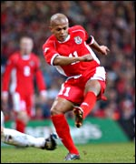 Wales striker Rob Earnshaw shoots