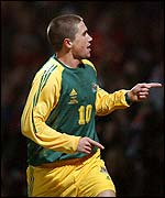 Harry Kewell celebrates scoring for Australia
