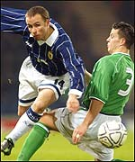Paul Devlin is challenged by Ian Harte