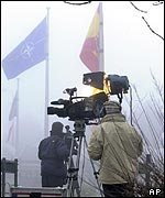 Camera crew waits outside Nato HQ