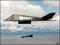 F-117 bomber flying over mountains