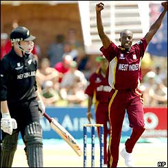 West Indies bowler Vasbert Drakes celebrates after taking his second wicket of the day, Scott Styris