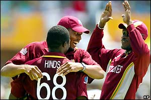 The West Indian team celebrate another New Zealand wicket