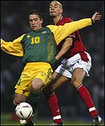 Australia's Harry Kewell (left) in action against Rio Ferdinand