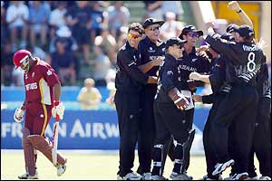 Brian Lara walks off the field as New Zealand celebrate after the West Indies ace batsman is dismissed for just two runs