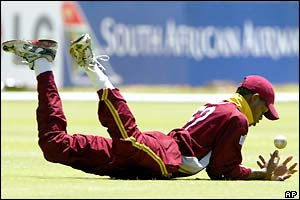 West Indies fielder Marlon Samuels drops a catch off the batting of Andre Adams