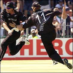 New Zealand's Chris Cairns is congratulated by team-mate Daniel Vettori after taking the wicket of Brian Lara