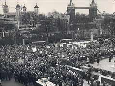 Miners march with Tower Bridge and the Tower of London in background