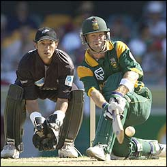 Jonty Rhodes plays a sweep shot against New Zealand in 2002