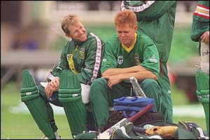 Jonty Rhodes chats with South African team mate Shaun Pollock