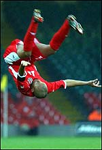 Robert Earnshaw celebrates scoring for Wales