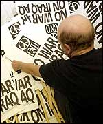 A British anti-war demonstrator prepares placards