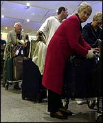 Passengers queuing at Gatwick