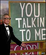 Scorsese in front of a blackboard bearing the words: