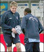 James Beattie shares a joke with Aston Villa's Darius Vassell