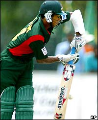 Bangladesh' s Alok Kapali hits out on his way to 32 runs as his side crumble against Sri Lanka