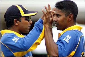 Mahela Jayawardene and Sri Lanka team-mate Chaminda Vaas celebrate after dismissing Bangladesh for 124 all out