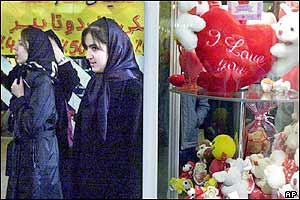 Iranian women pass as a shop displaying Valentine's day hearts and toys in the capital, Tehran.