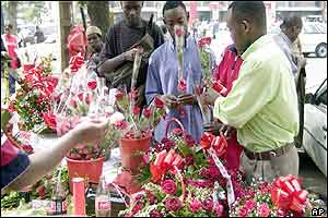 Kenyans line up to buy roses from a street vendor in the capital Nairobi