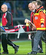 Jens Nowotny is stretchered off against Manchester United