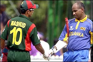 Bangladesh captain Khaled Mashud shakes the hand of Sri Lankan counterpart Sanath Jayasuriya at the end of the match