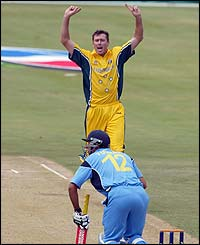 Glenn McGrath celebrates after dismissing India's Yuvraj Singh lbw