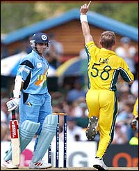 Brett Lee celebrates taking the wicket of India's opener Sourav Ganguly