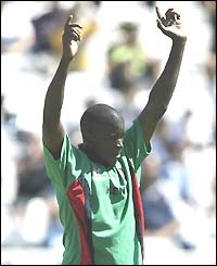 Kenyan bowler Peter Ongondo celebrates taking the wicket of Canada's John Davison