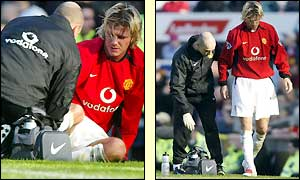 Man Utd midfielder David Beckham is treated before leaving the field injured