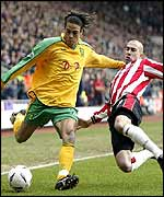 Darel Russell (left) is challenged by Danny Higginbotham