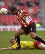 Sunderland's Phil Babb heads clear
