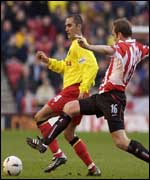 Jason McAteer tackles Paolo Vernazza