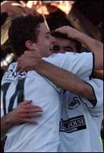 Marc Richards and Roberto Martinez celebrate Swansea's first goal
