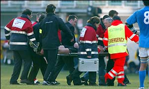 Wales and Llanelli winger Mark Jones is stretchered off the pitch