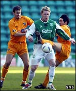 Garry O'Connor holds off two defenders