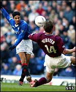 Arteta squeezes a shot in past Andy Webster
