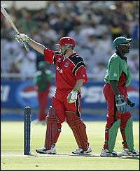 Ian Billcliff of Canada reaches his 50 against Kenya