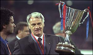 Robson holds the European Cup Winners Cup aloft as manager of Barcelona in 1997