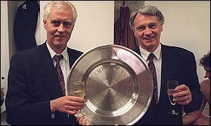 Robson holds the Dutch League championship shield after winning it with PSV Eindhoven in 1991