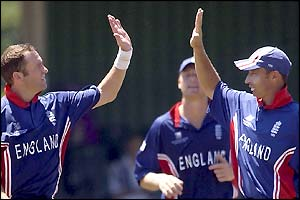 England bowler Craig White gives captain Nasser Hussain a high-five after taking the wicket of Adeel Raja