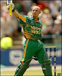 South African batsman Herschelle Gibbs salutes the crowd after scoring his century