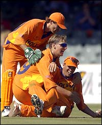 The Dutch team celebrate after captain Roland Lefebvre takes the wicket of Andrew Flintoff